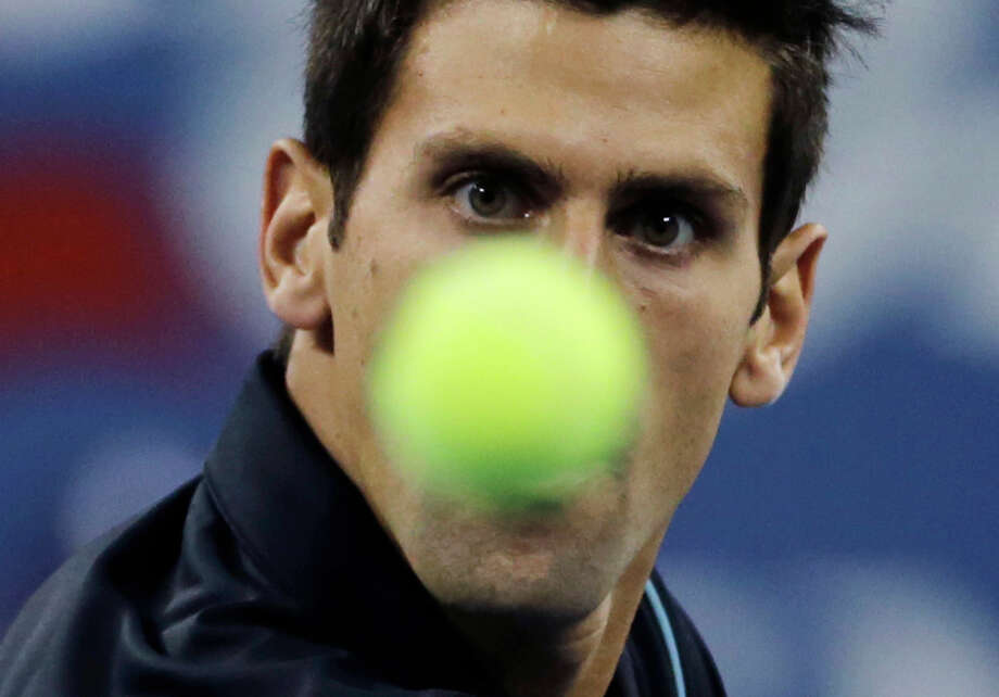Novak Djokovic, of Serbia, eyes the ball as he returns to Mikhail Youzhny, of Russia, during the men's quarterfinal round at the 2013 U.S. Open tennis tournament, Thursday, Sept. 5, 2013, in New York. Photo: Charles Krupa, ASSOCIATED PRESS / AP2013