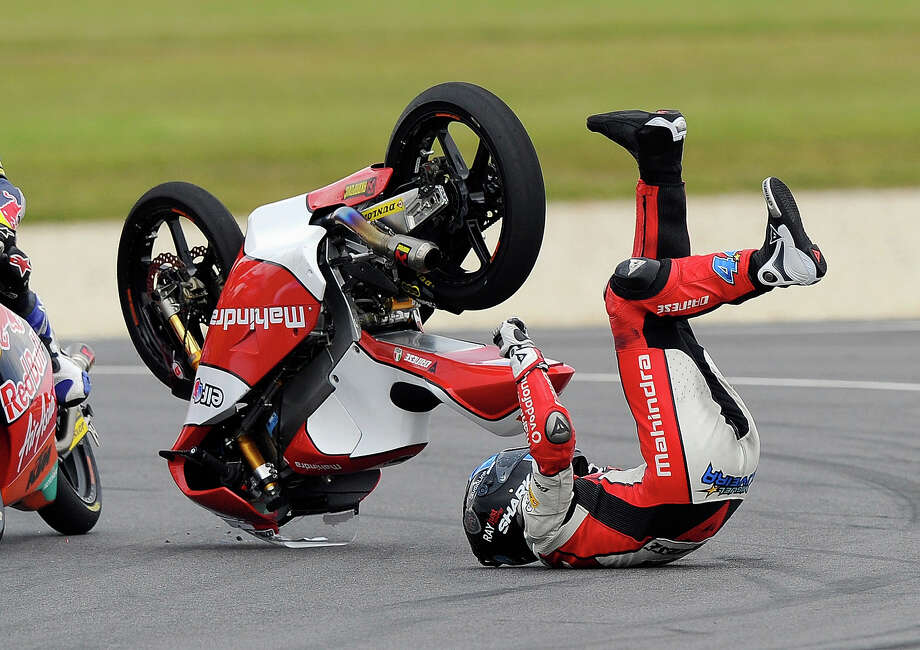 Miguel Oliveira of Portugal crashes on turn four during the Moto2 race at the Australian Motorcycle Grand Prix in Phillip Island, Australia, Sunday, Oct. 20, 2013. Photo: Andrew Brownbill, AP / AP