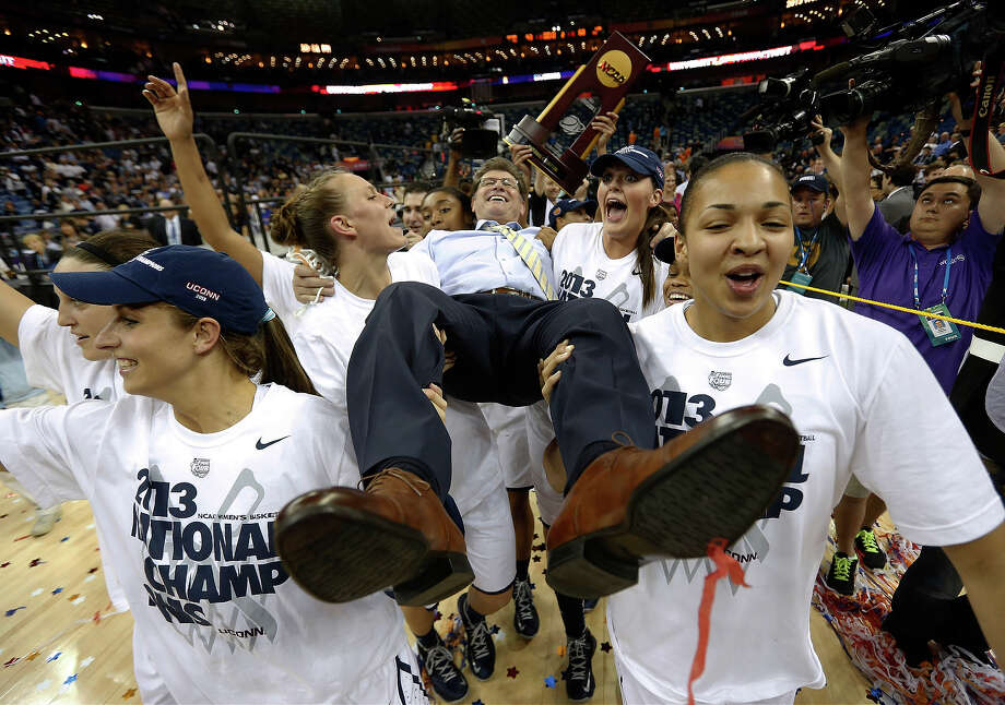 Connecticut players celebrate as they carry their head coach Geno Auriemma after defeating Louisville 93-60 in the national championship game of the women's Final Four of the NCAA college basketball tournament, Tuesday, April 9, 2013, in New Orleans. Photo: Dave Martin, ASSOCIATED PRESS / AP2013