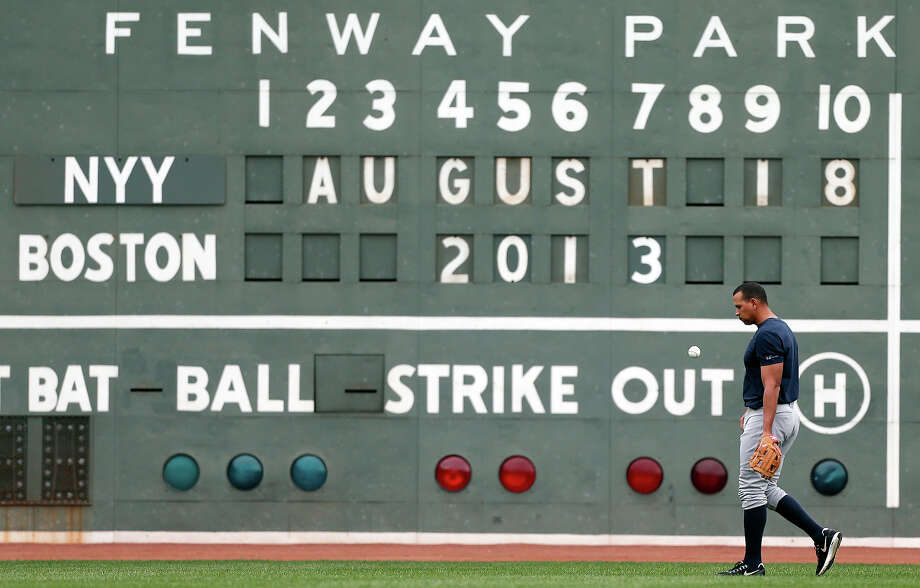 New York Yankees' Alex Rodriguez walks in front of the left field scoreboard before a baseball game against the Boston Red Sox, Sunday, Aug. 18, 2013, in Boston. Photo: Michael Dwyer, ASSOCIATED PRESS / AP2013
