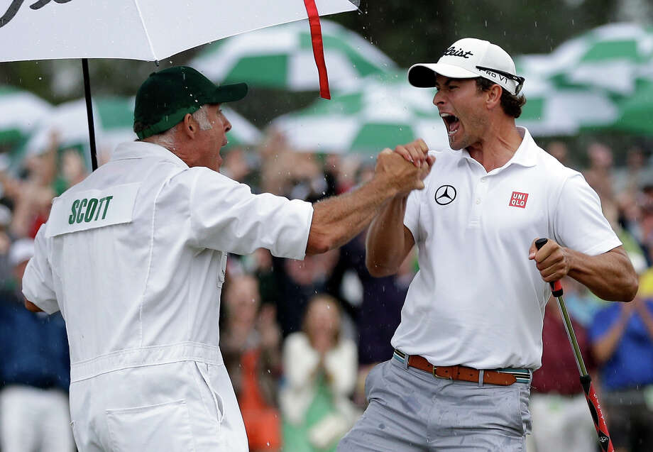 Adam Scott, of Australia, celebrates with his caddie Steve Williams celebrates after a birdie putt on the 18th green during the fourth round of the Masters golf tournament Sunday, April 14, 2013, in Augusta, Ga. Photo: David J. Phillip, ASSOCIATED PRESS / AP2013
