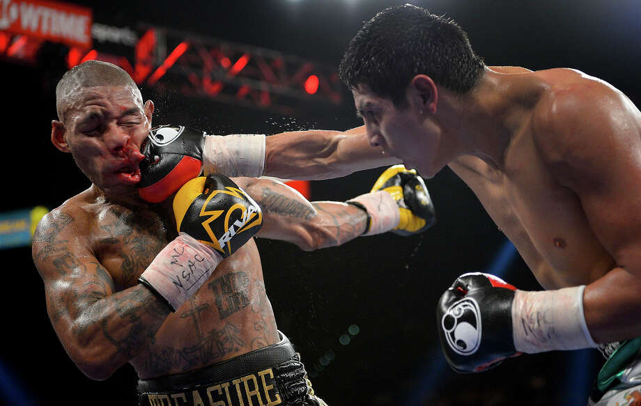 Pablo Cesar Cano, right, lands a punch against Ashley Theophane in the eighth round during a welterweight fight, Saturday, Sept. 14, 2013, in Las Vegas. Photo: Mark J. Terrill, ASSOCIATED PRESS / AP2013