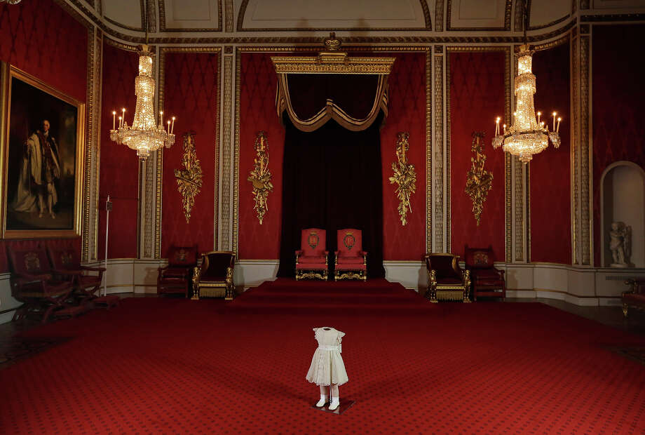 The outfit worn by the two-year-old Princess Anne at Britain's Queen Elizabeth II's Coronation on June 2, 1953, is seen during a photo opportunity at the Throne Room of Buckingham Palace in central London, Thursday, Jan. 24, 2013. Summer 2013 marked the 60th anniversary the Coronation and a special exhibition at Buckingham Palace will brang together an array of the dress, uniform and robes worn on that occasion. Photo: Lefteris Pitarakis, ASSOCIATED PRESS / AP2013