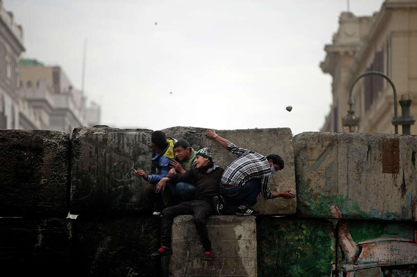 Skirmishes break out between protesters and security forces, unseen, near Tahrir Square, Cairo, Egyp