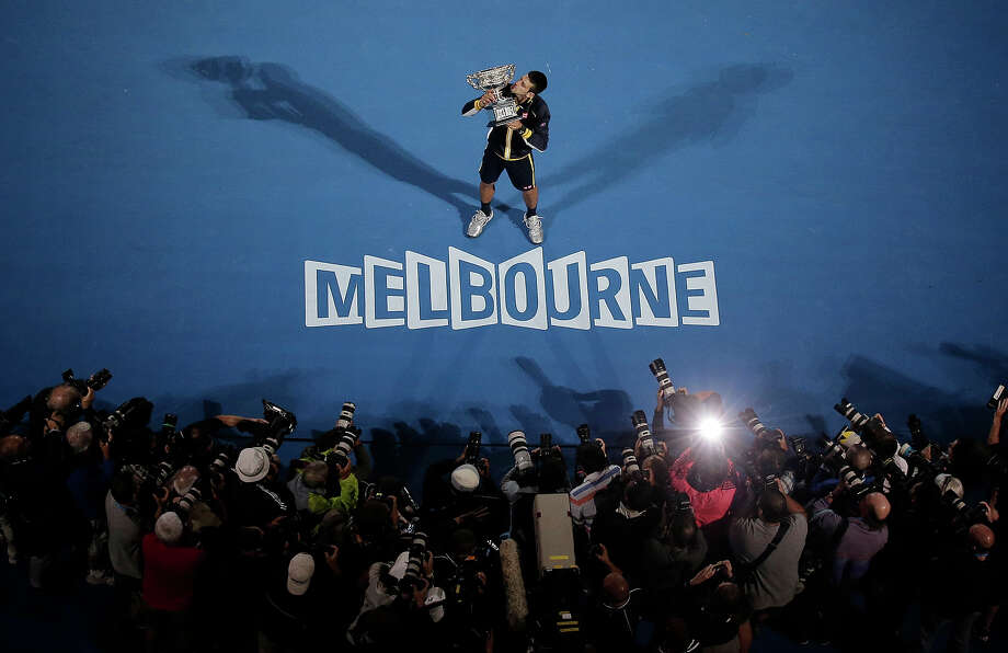 Serbia's Novak Djokovic holds his trophy after defeating Britain's Andy Murray in the men's final at the Australian Open tennis championship in Melbourne, Australia, Sunday, Jan. 27, 2013. Photo: Rob Griffith, ASSOCIATED PRESS / AP2013
