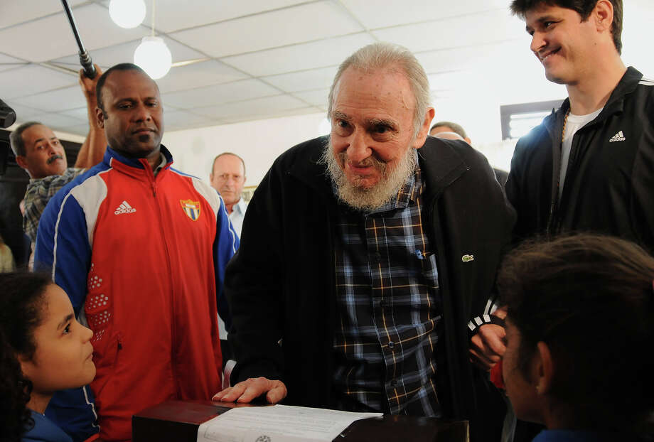 Cuba's leader Fidel Castro votes at a polling station during parliament elections in Havana, Cuba, Sunday, Feb. 3, 2013. Castro, who appears in public only occasionally, was among more than 8 million islanders eligible to vote and approve 612 members of the National Assembly and over 1,600 provincial delegates. Photo: Ismael Francisco, ASSOCIATED PRESS / AP2013