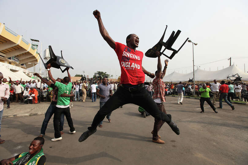 Nigeria soccer fans celebrate after Nigeria soccer player Elderson Echiejile  scored a goal against