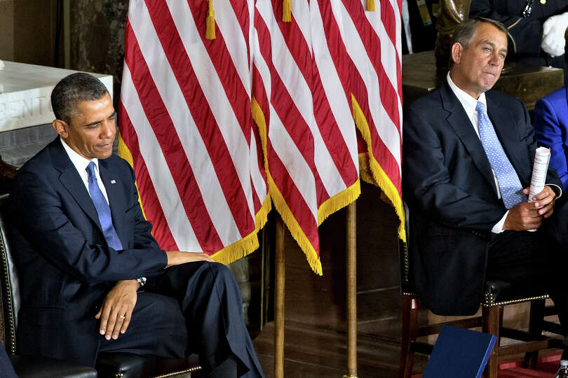 President Barack Obama, left, and House Speaker John Boehner of Ohio sit during a ceremony to dedica