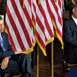 President Barack Obama, left, and House Speaker John Boehner of Ohio sit during a ceremony to dedicate a statue of civil rights icon Rosa Parks, Wednesday, Feb. 27, 2013, in the Capitol's Statuary Hall.