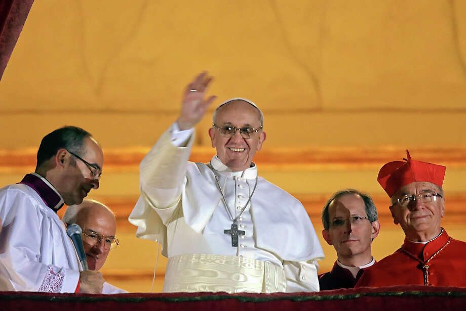 Pope Francis waves to the crowd from the central balcony of St. Peter's Basilica at the Vatican, Wednesday, March 13, 2013. Cardinal Jorge Bergoglio, who chose the name of Francis is the 266th pontiff of the Roman Catholic Church. Photo: Gregorio Borgia, ASSOCIATED PRESS / AP2013