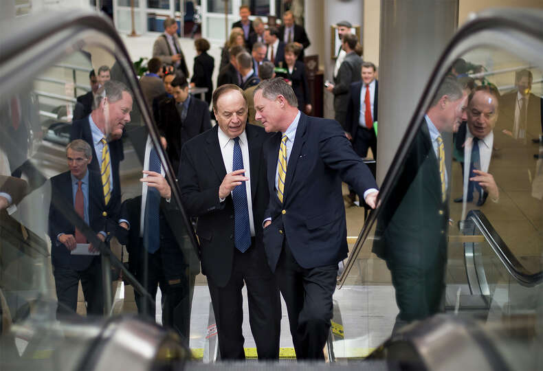 Sen. Richard Burr, R-N.C., center right, and Sen. Richard Shelby, R-Ala., left, ride an escalator as