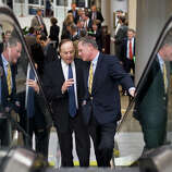 Sen. Richard Burr, R-N.C., center right, and Sen. Richard Shelby, R-Ala., left, ride an escalator as lawmakers rush to the Senate floor to vote on amendments to the budget resolution, at the Capitol in Washington, Friday, March 22, 2013.