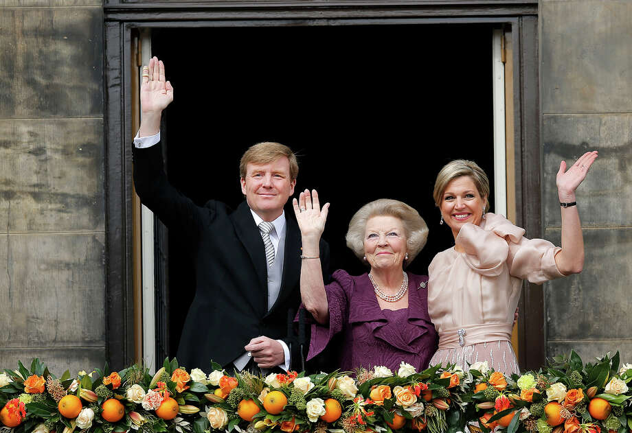 Dutch King Willem-Alexander, Queen Maxima, right, and Princess Beatrix appear on the balcony of the Royal Palace in Amsterdam, The Netherlands, Tuesday April 30, 2013. Willem-Alexander was the first new Dutch monarch in 33 years. Photo: Daniel Ochoa De Olza, ASSOCIATED PRESS / AP2013