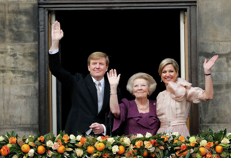 Dutch King Willem-Alexander, Queen Maxima, right, and Princess Beatrix appear on the balcony of the