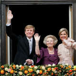 Dutch King Willem-Alexander, Queen Maxima, right, and Princess Beatrix appear on the balcony of the Royal Palace in Amsterdam, The Netherlands, Tuesday April 30, 2013. Willem-Alexander was the first new Dutch monarch in 33 years.