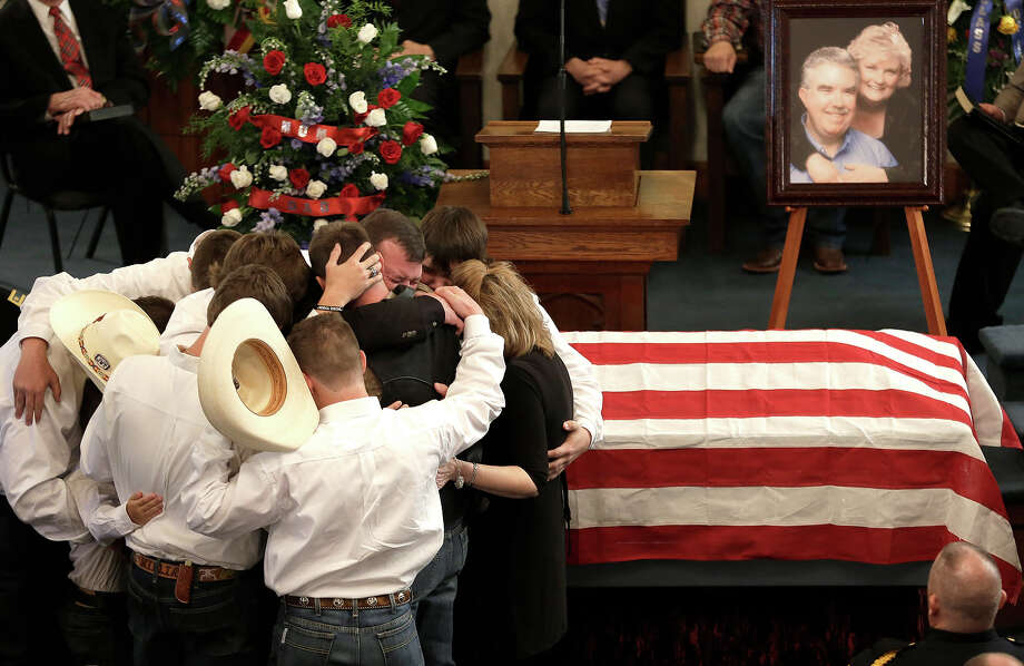 The family of Kaufman County District Attorney Mike McLelland and his wife, Cynthia, comfort each other during their funeral services at  the First Baptist Church of Wortham Friday, April 5, 2013, in Wortham, Texas.  The couple was found shot to death in their house near Forney, about 20 miles east of Dallas. Photo: LM Otero, ASSOCIATED PRESS / AP2013