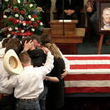 The family of Kaufman County District Attorney Mike McLelland and his wife, Cynthia, comfort each other during their funeral services at  the First Baptist Church of Wortham Friday, April 5, 2013, in Wortham, Texas.  The couple was found shot to death in their house near Forney, about 20 miles east of Dallas.