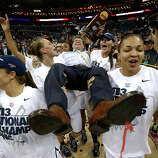 Connecticut players celebrate as they carry their head coach Geno Auriemma after defeating Louisville 93-60 in the national championship game of the women's Final Four of the NCAA college basketball tournament, Tuesday, April 9, 2013, in New Orleans.