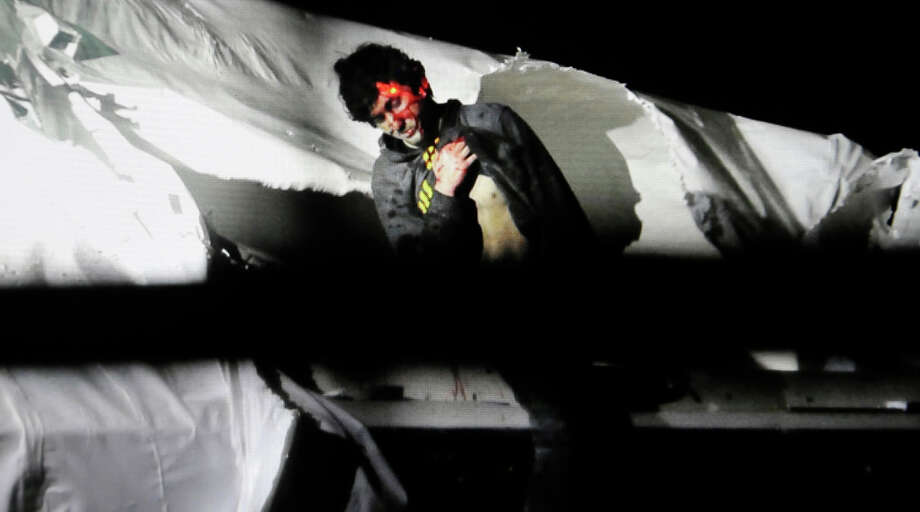 In this Friday, April 19, 2013 Massachusetts State Police photo, 19-year-old Boston Marathon bombing suspect Dzhokhar Tsarnaev leans over in a boat at the time of his capture by law enforcement authorities in Watertown, Mass. Photo: Sean Murphy, ASSOCIATED PRESS / AP2013