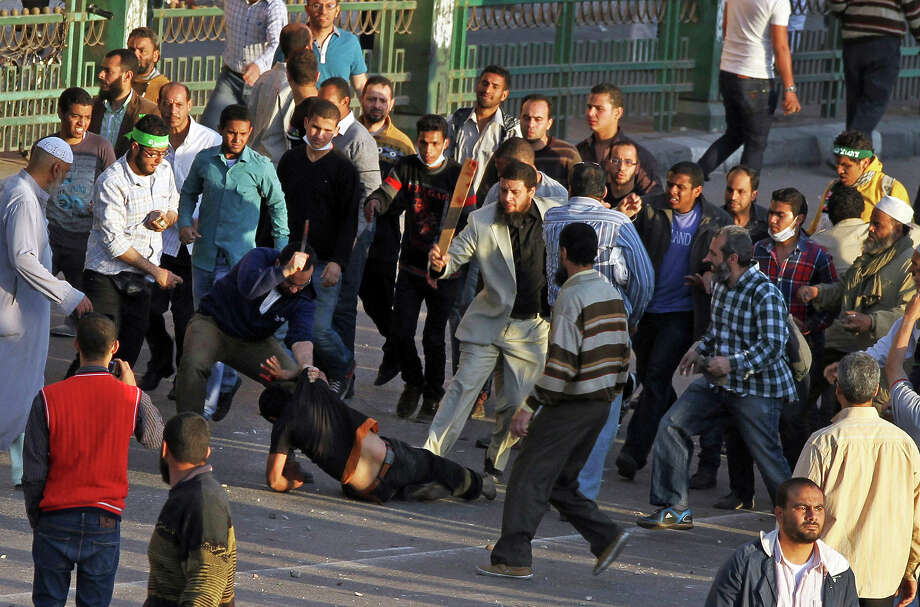 Muslim Brotherhood supporters beat a protester in Tahrir Square, as supporters and opponents of Egypt's Islamist president battle in Cairo, Egypt, Friday, April 19, 2013. Photo: Ahmed Gomaa, ASSOCIATED PRESS / AP2013