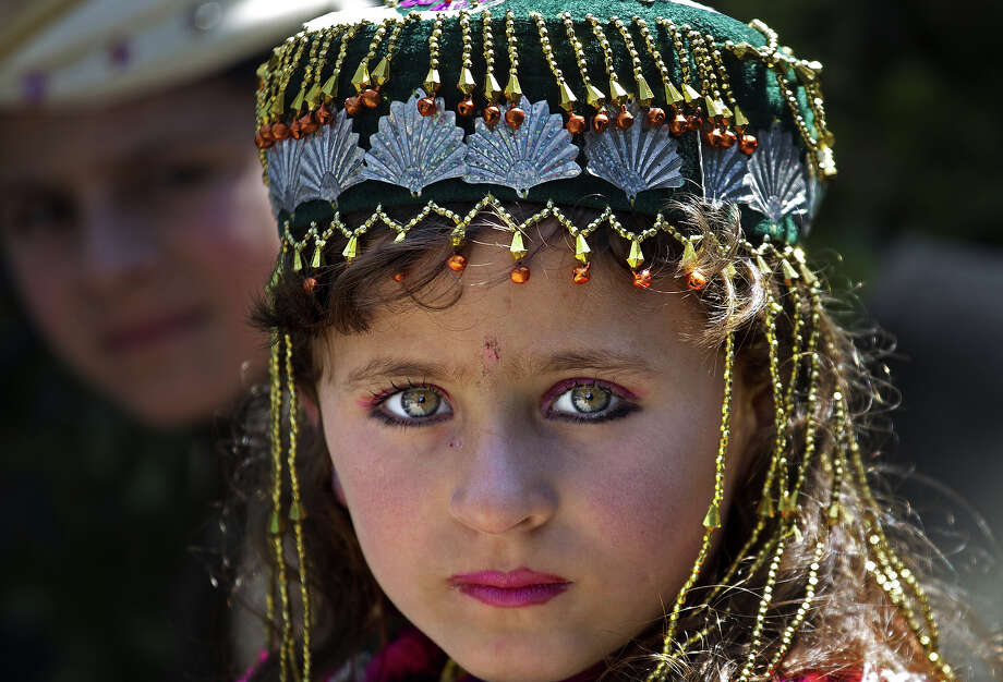 A Pakistani internally displaced girl Amina Bibi attends class at a school rebuilt by the Pakistani army, in Tank, the bordering town of South Waziristan, the Pakistani tribal area bordering Afghanistan, March 28, 2013. Photo: B.K. Bangash, ASSOCIATED PRESS / AP2013