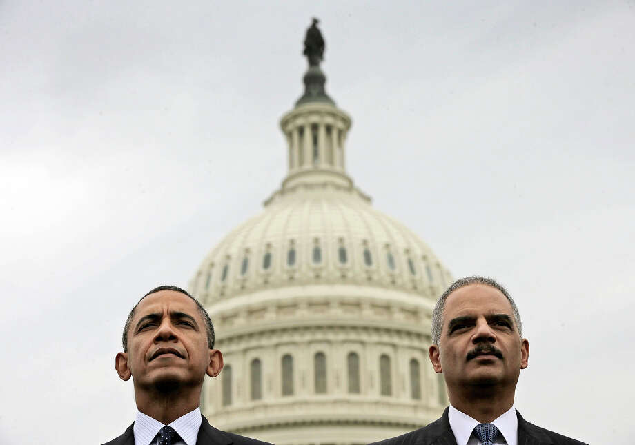 President Barack Obama sits with Attorney General Eric Holder during the 32nd annual the National Peace Officers Memorial Service, Wednesday, May 15, 2013, on Capitol Hill in Washington, honoring law enforcement officers who died in the line of duty. Photo: Pablo Martinez Monsivais, ASSOCIATED PRESS / THE ASSOCIATED PRES2013