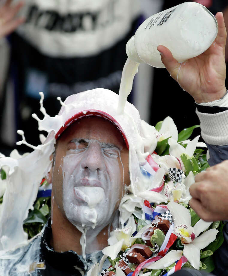 Tony Kanaan, of Brazil, celebrates with winners milk after winning the Indianapolis 500 auto race at the Indianapolis Motor Speedway in Indianapolis, Sunday, May 26, 2013. Photo: Michael Conroy, ASSOCIATED PRESS / AP2013