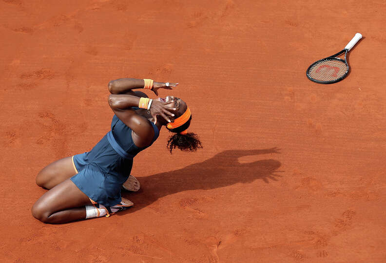 Serena Williams, of the U.S, celebrates as she defeats Russia's Maria Sharapova during the Women's f