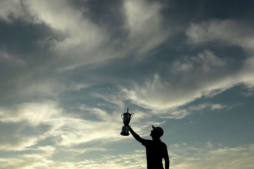 Justin Rose, of England, poses with the trophy after winning the U.S. Open golf tournament at Merion