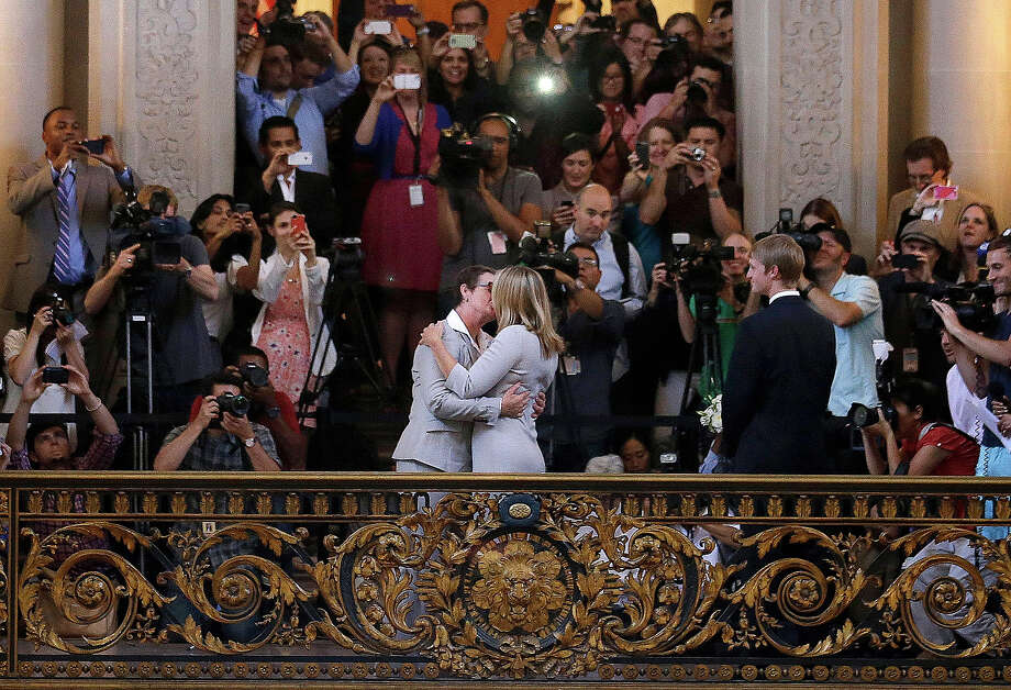 Kris Perry, foreground left, kisses Sandy Stier as they are married at City Hall in San Francisco, Friday, June 28, 2013. Stier and Perry were married after a federal appeals court cleared the way for the state of California to immediately resume issuing marriage licenses to same-sex couples after a 4 1/2-year freeze. Photo: Jeff Chiu, ASSOCIATED PRESS / AP2013