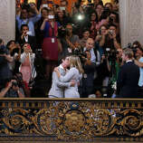 Kris Perry, foreground left, kisses Sandy Stier as they are married at City Hall in San Francisco, Friday, June 28, 2013. Stier and Perry were married after a federal appeals court cleared the way for the state of California to immediately resume issuing marriage licenses to same-sex couples after a 4 1/2-year freeze.