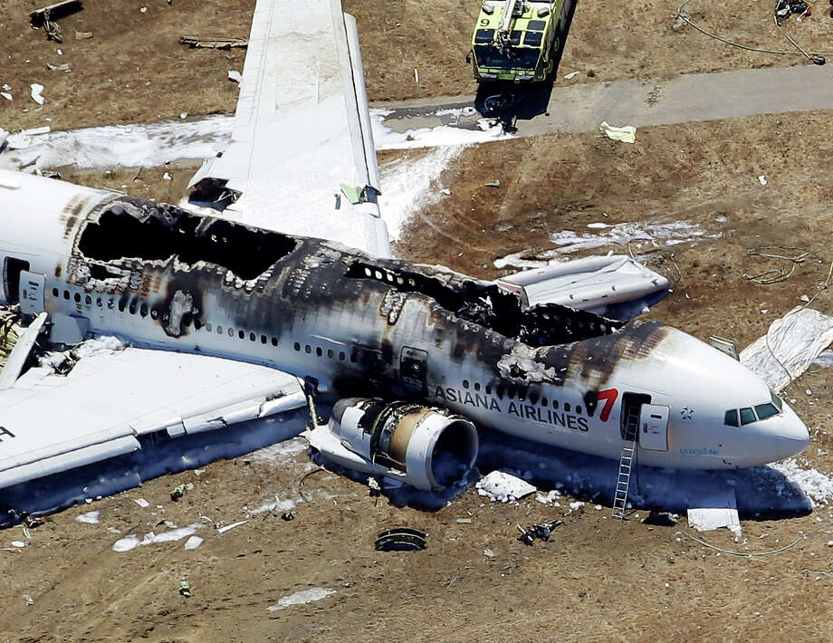 This aerial photo shows the wreckage of the Asiana Flight 214 airplane after it crashed at the San Francisco International Airport in San Francisco, Saturday,  July 6, 2013. Photo: Marcio Jose Sanchez, ASSOCIATED PRESS / AP2013