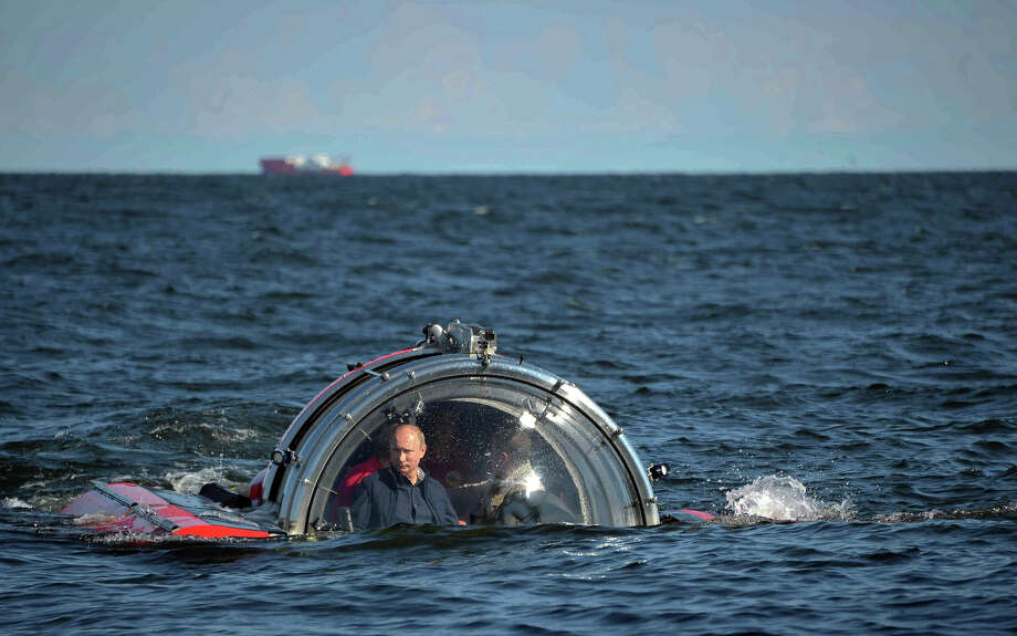Russian President Vladimir Putin submerges on board Sea Explorer 5 bathyscaphe off the island of Gogland 180 kilometers (110 miles) west of St. Petersburg, Russia, Monday, July 15, 2013. Putin rode a small submersible craft 60 meters (200 feet) down to see the remains of the naval frigate Oleg, which sank in 1869. Photo: Alexei Nikolsky, ASSOCIATED PRESS / AP2013