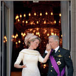 Belgium's King Philippe, right, kisses the hand of Queen Mathilde as they stand on the balcony of the royal palace in Brussels on Sunday, July 21, 2013. Philippe had taken the oath before parliament to become Belgium's seventh king after his father Albert II abdicated as the head of this fractured nation.