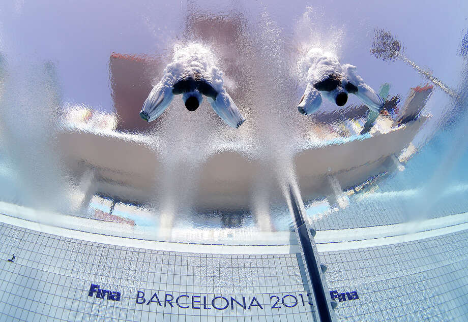 Sascha Klein and Patrick Hausding of Germany compete in the men's 10-meter synchro platform preliminary competition at the FINA Swimming World Championships in Barcelona, Spain, Sunday, July 21, 2013. Photo: David J. Phillip, ASSOCIATED PRESS / AP2013