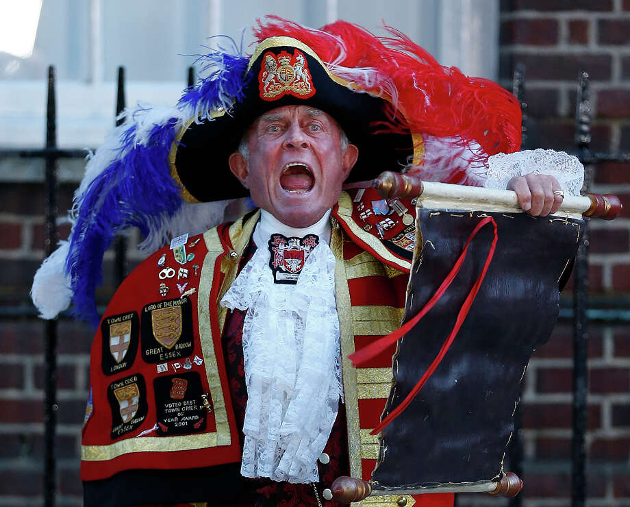 Tony Appleton, a town crier,  announces the birth of the royal baby, outside St. Mary's Hospital exclusive Lindo Wing in London, Monday, July 22, 2013. Photo: Lefteris Pitarakis, ASSOCIATED PRESS / A2013