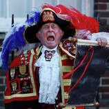 Tony Appleton, a town crier,  announces the birth of the royal baby, outside St. Mary's Hospital exclusive Lindo Wing in London, Monday, July 22, 2013.