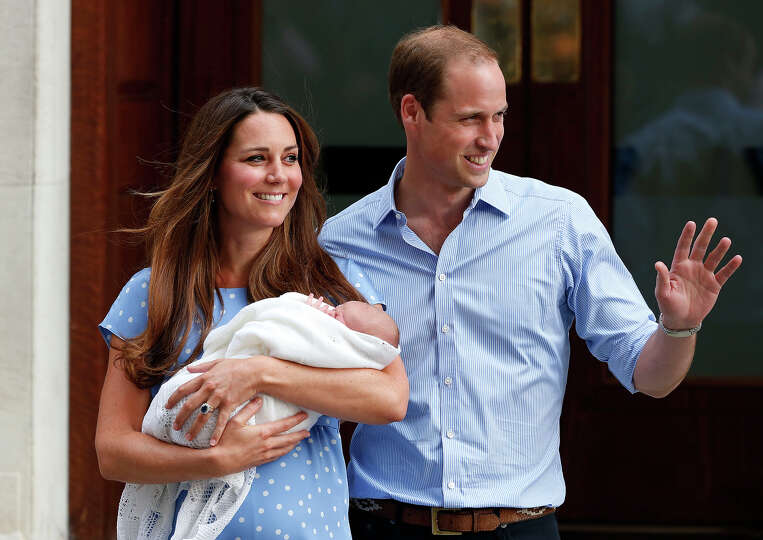 Britain's Prince William and Kate, Duchess of Cambridge hold the Prince of Cambridge, Tuesday July 2