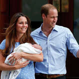 Britain's Prince William and Kate, Duchess of Cambridge hold the Prince of Cambridge, Tuesday July 23, 2013, as they pose for photographers outside St. Mary's Hospital exclusive Lindo Wing in London where the Duchess gave birth.
