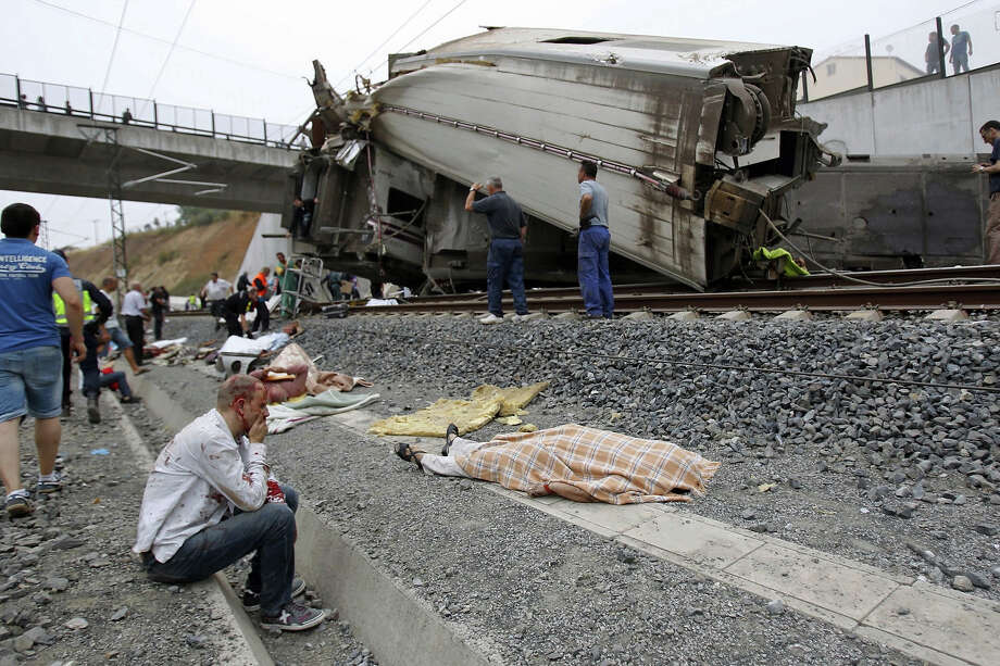In this photo taken on July 24 2013, wounded people and dead bodies are seen at the site of a train accident in Santiago de Compostela, Spain, July 24, 2013. Photo: La Voz De Galicia/Xoan A. Soler, ASSOCIATED PRESS / AP2013