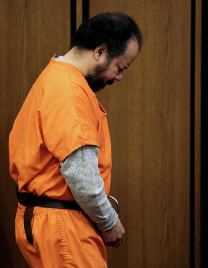 Ariel Castro walks into the courtroom Wednesday, July 24, 2013, in Cleveland. Castro pled guilty to
