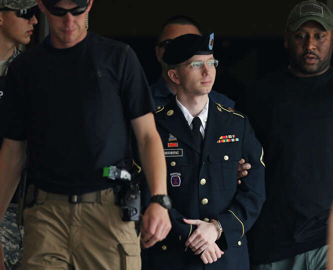 Army Pfc. Bradley Manning is escorted out of a courthouse in Fort Meade, Md., Tuesday, July 30, 2013