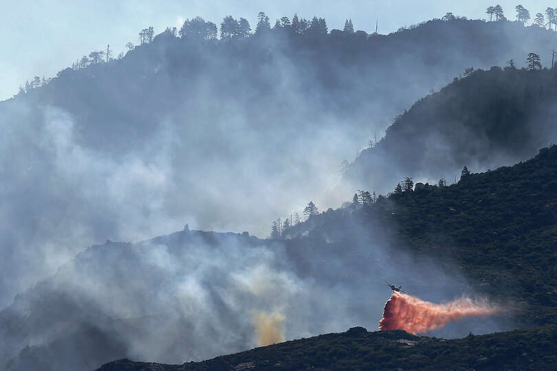 An air tanker drops fire retardant on a hot spot as firefighters continue to battle a wildfire on Fr
