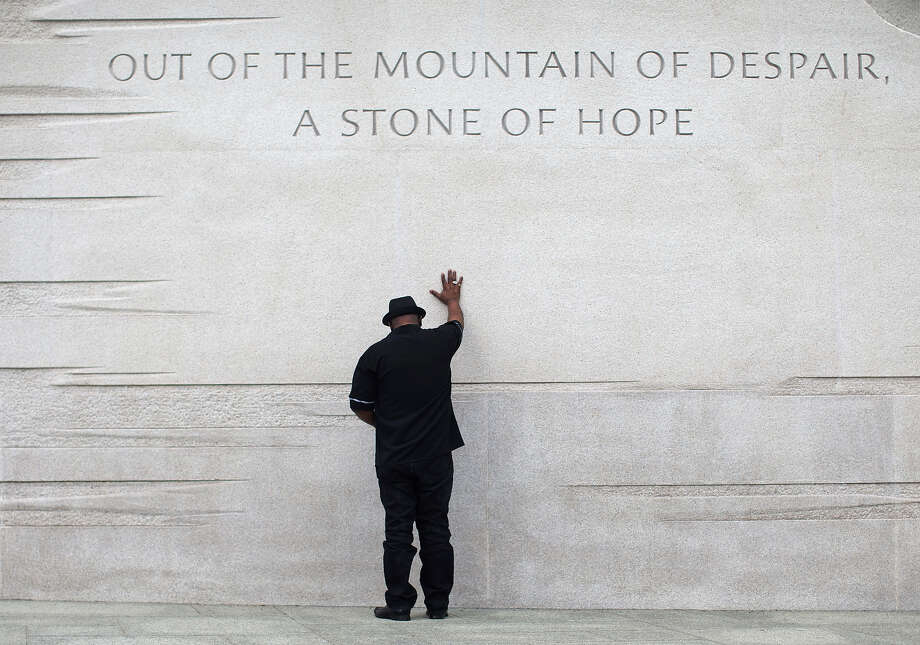 Rev. Bobby Turner or Columbus, Ohio, places his hand on the Martin Luther King Jr. Memorial, Thursday, Aug. 22, 2013, in Washington. Photo: Carolyn Kaster, ASSOCIATED PRESS / AP2013