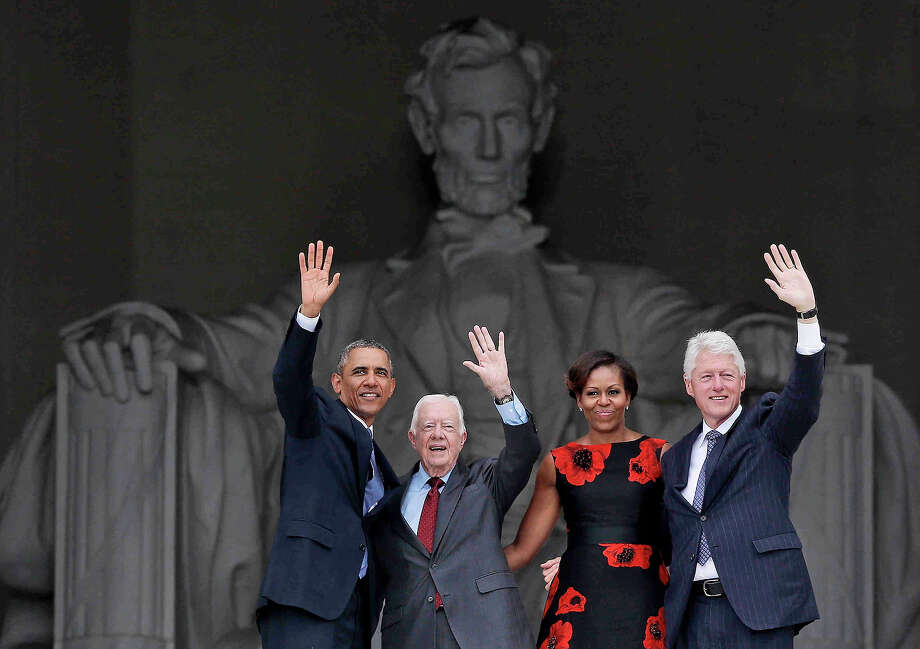 President Barack Obama, first lady Michelle Obama, former President Jimmy Carter and former President Bill Clinton wave as they leave 50th Anniversary of the March on Washington where Martin Luther King Jr., spoke, Wednesday, Aug. 28, 2013, at  the Lincoln Memorial in Washington. Photo: Charles Dharapak, ASSOCIATED PRESS / AP2013