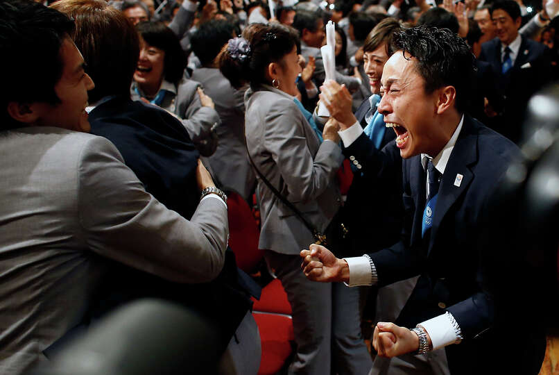 Members of the Tokyo 2020 delegation celebrate after Tokyo was awarded the 2020 Olympic Games during