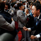 Members of the Tokyo 2020 delegation celebrate after Tokyo was awarded the 2020 Olympic Games during the 125th IOC session in Buenos Aires, Argentina,  Saturday, Sept. 7, 2013.