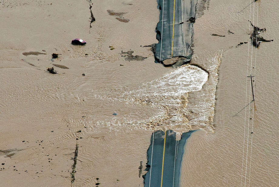 A section of highway is washed out by flooding along the South Platte River in Weld County, Colorado near Greeley, Saturday, Sept. 14, 2013.  Hundreds of roads in the area were damaged or destroyed by the floodwaters that have affected parts of a 4,500-square-mile area — an area the size of the Connecticut. Photo: John Wark, ASSOCIATED PRESS / AP2013