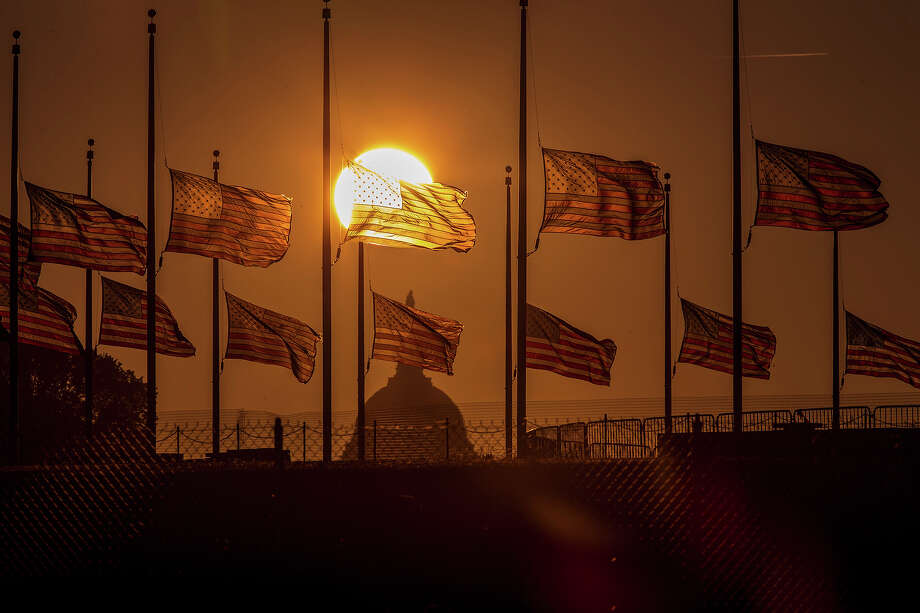 The flags surrounding the Washington Monument fly at half-staff as ordered by President Barack Obama following the deadly shooting Monday at the Washington Navy Yard, Tuesday morning, Sept. 17, 2013, in Washington. Photo: J. Scott Applewhite, ASSOCIATED PRESS / The Associated Press2013