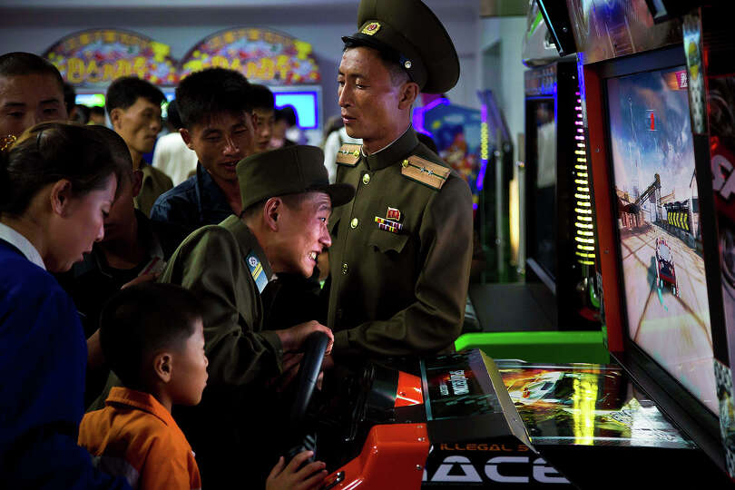 North Koreans soldiers play an arcade game at the Pyongyang Pleasure park Sept. 22, 2013, in Pyongya
